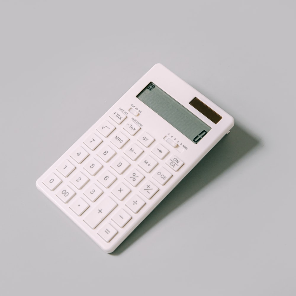 white calculator on white table