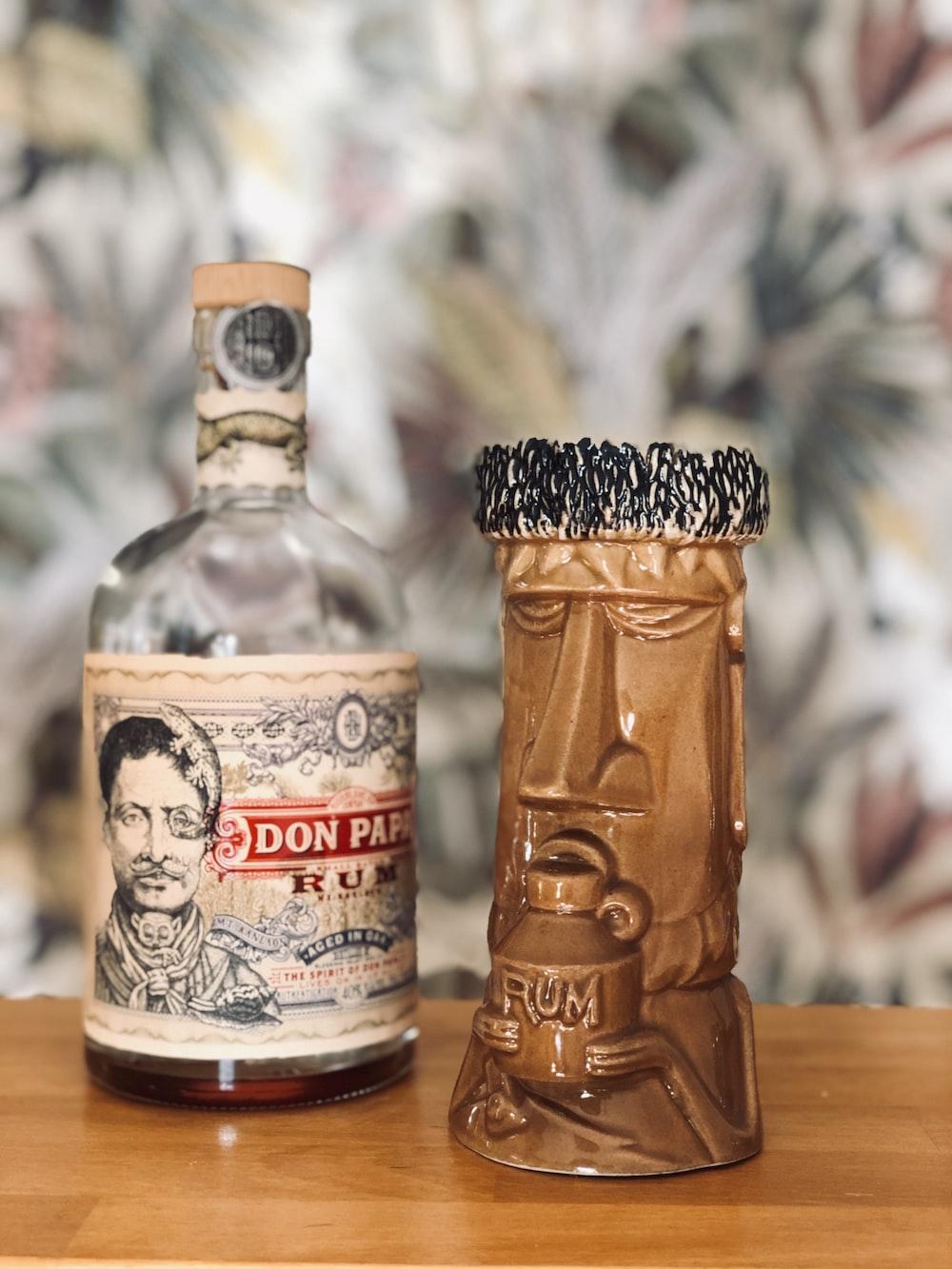 jack daniels bottle on brown wooden table