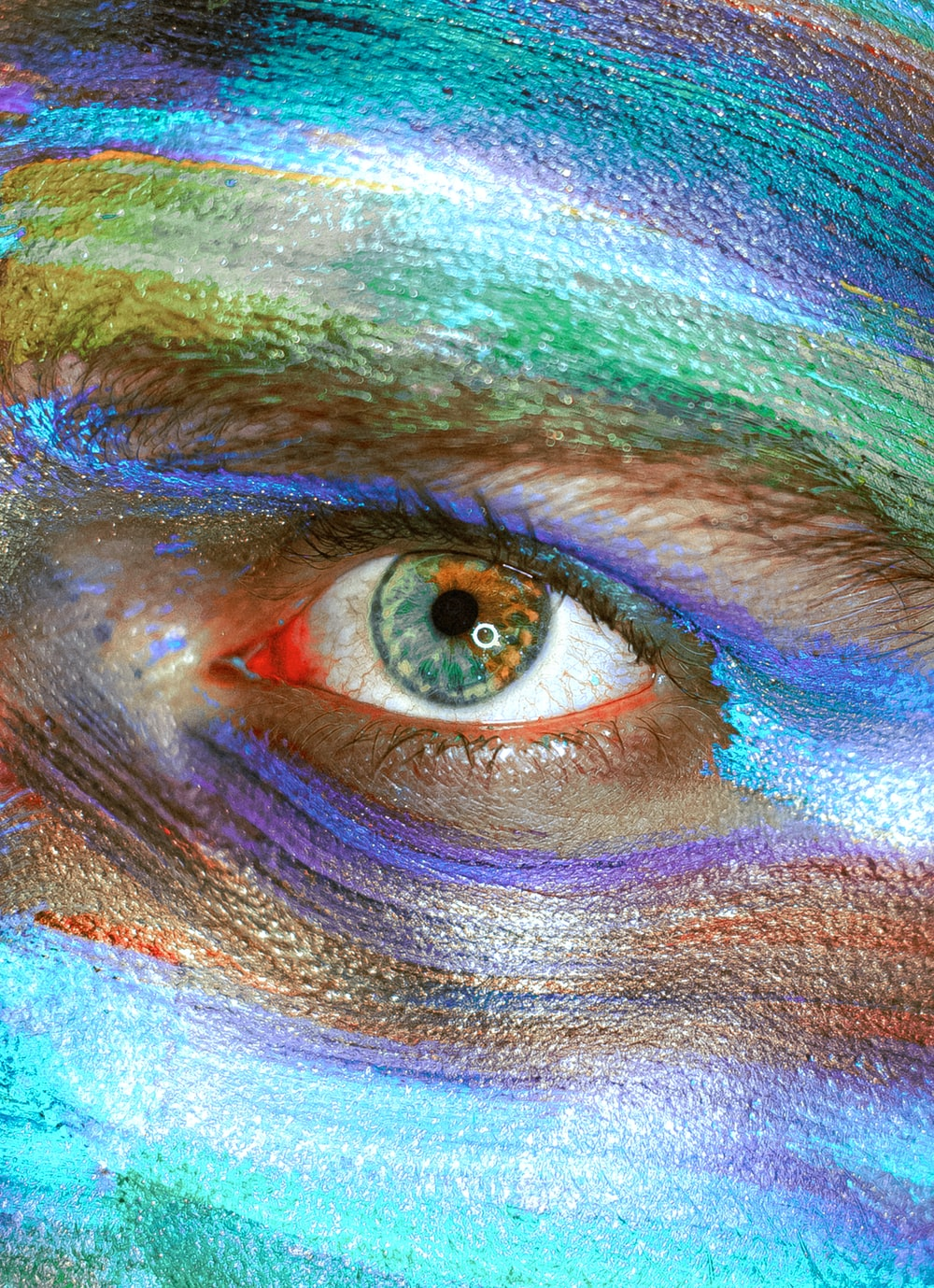 person with blue and green eye