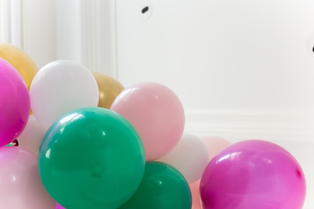 purple and pink balloons on white wall