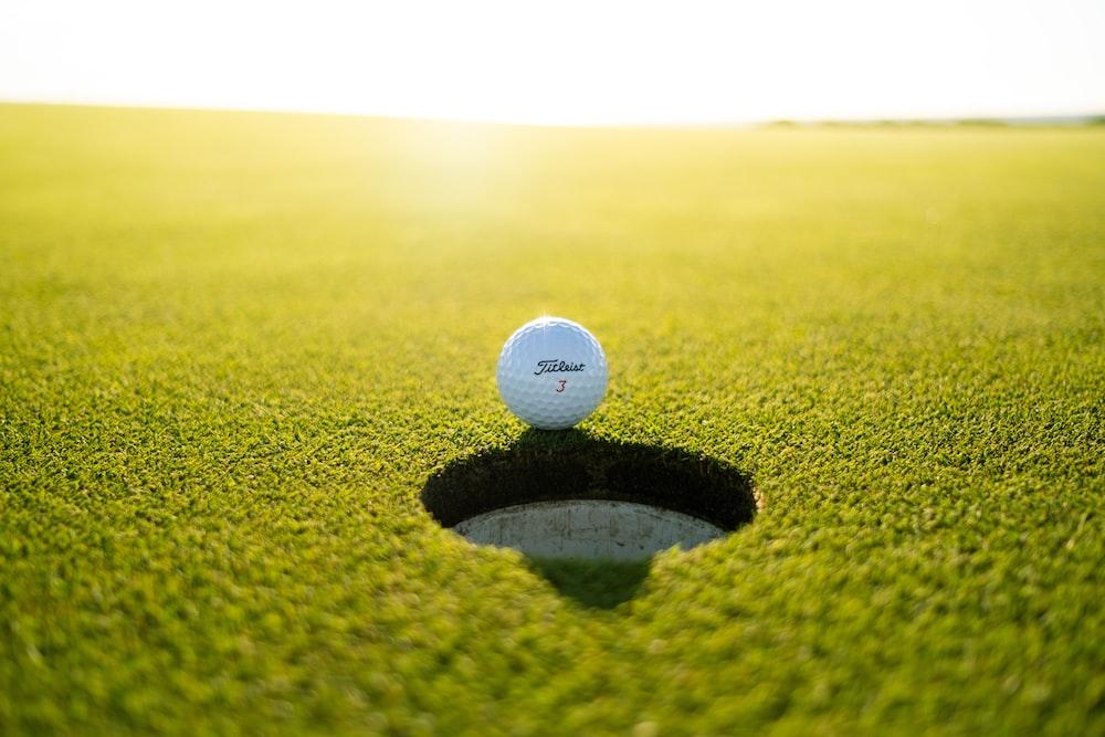 golf ball on green grass field during daytime