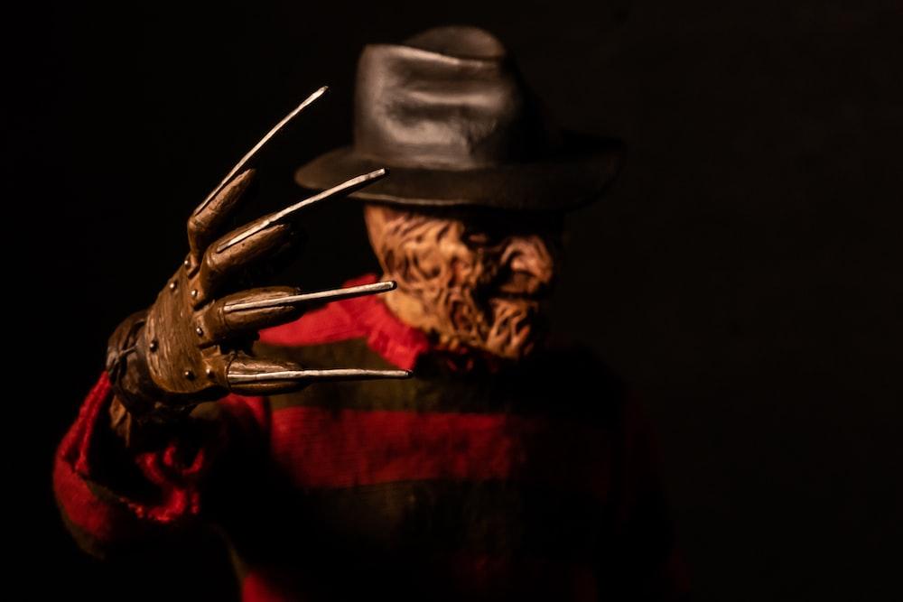 man in brown cowboy hat