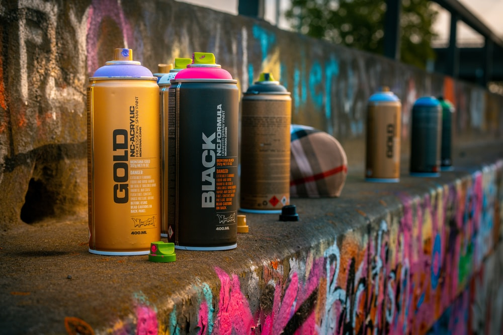 yellow and black spray can
