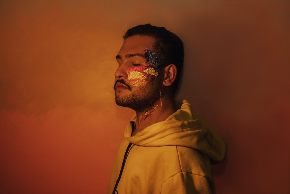 man in brown hoodie standing
