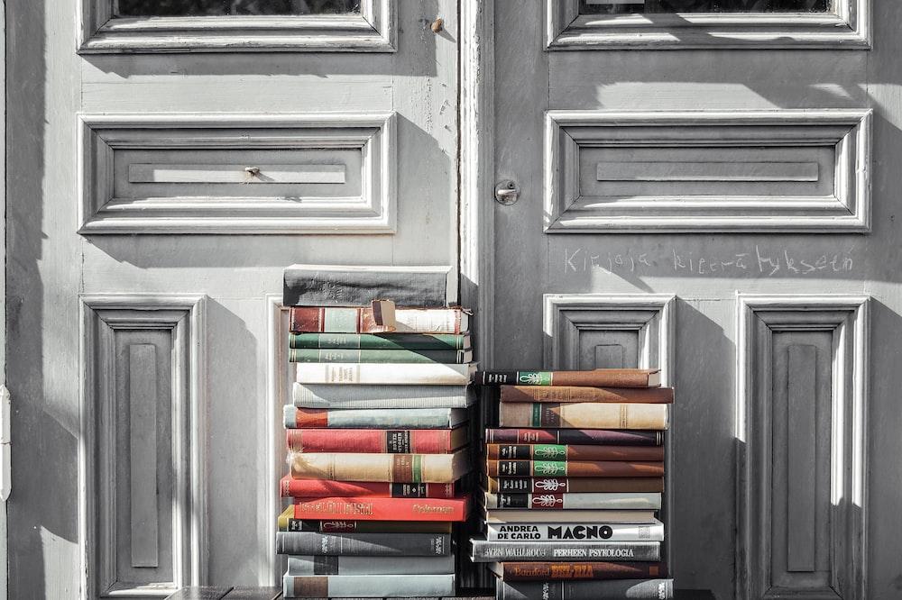 books on gray wooden door
