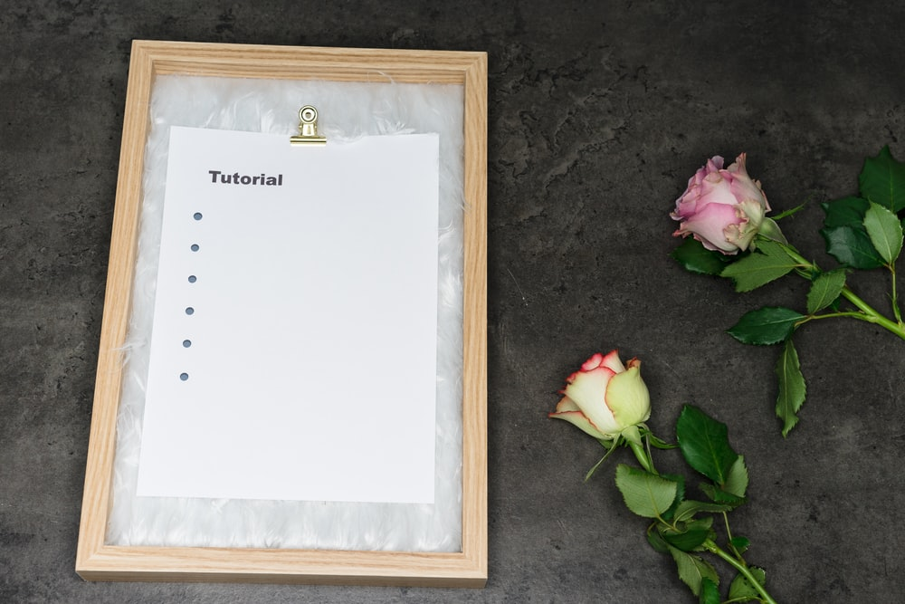 brown wooden frame with white paper