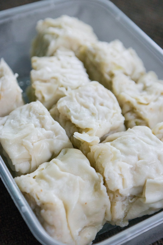 white dumplings on stainless steel tray