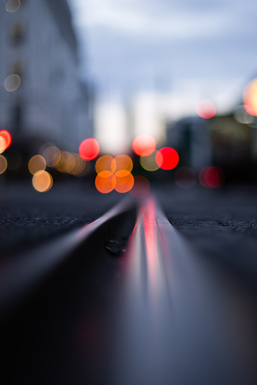 black asphalt road with white and pink lights