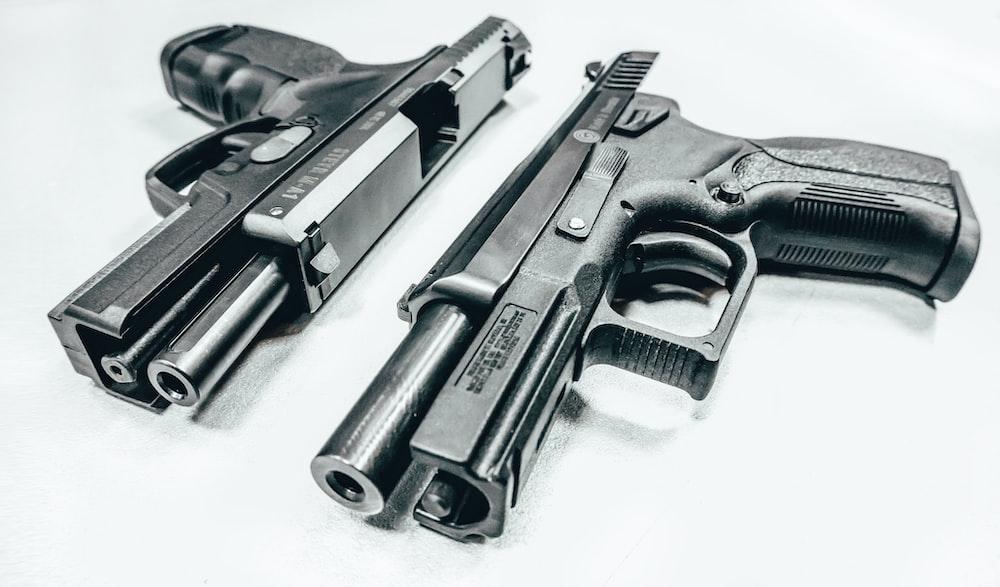 black semi automatic airsoft pistol on white textile