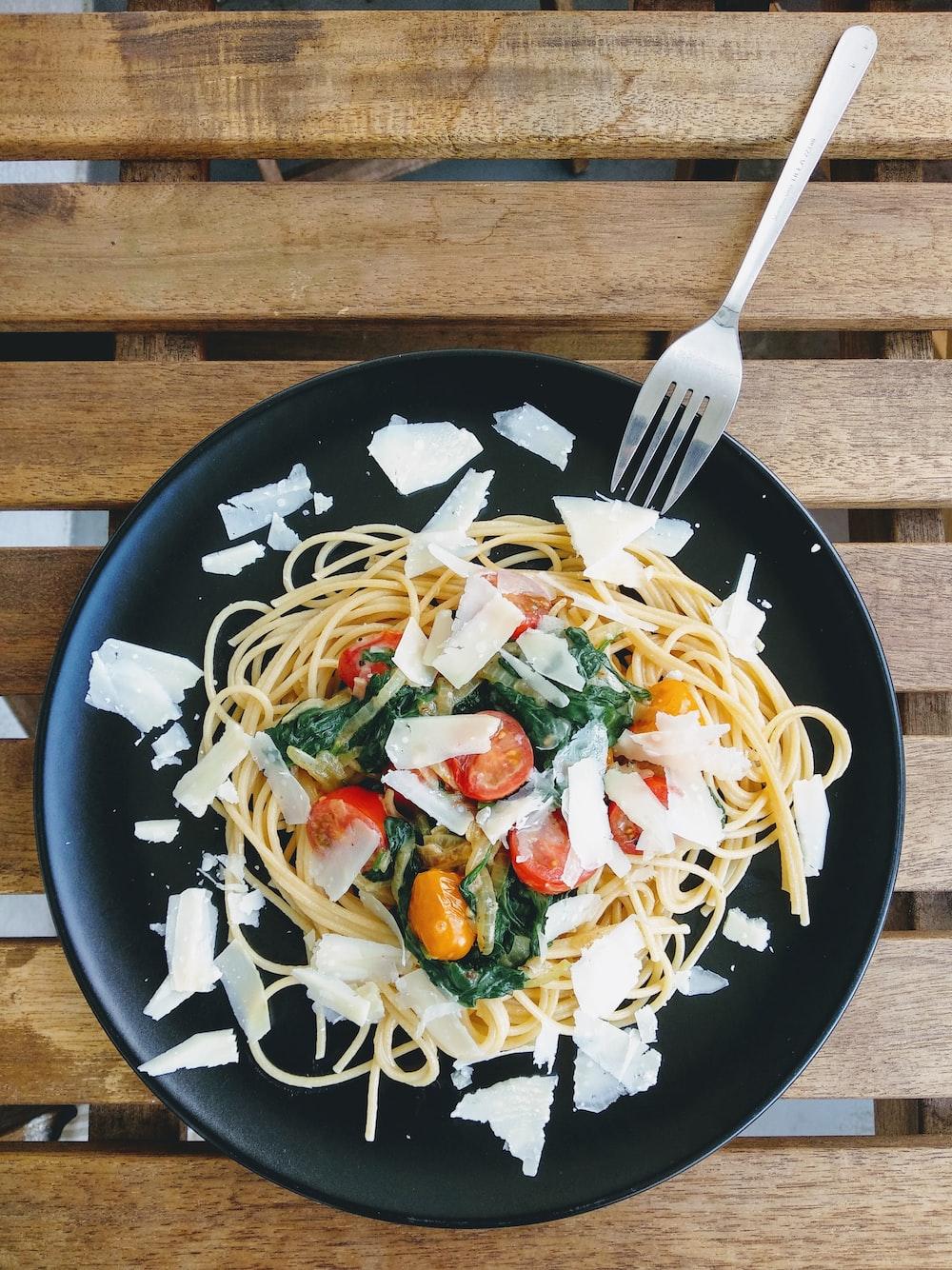 pasta dish on black ceramic plate