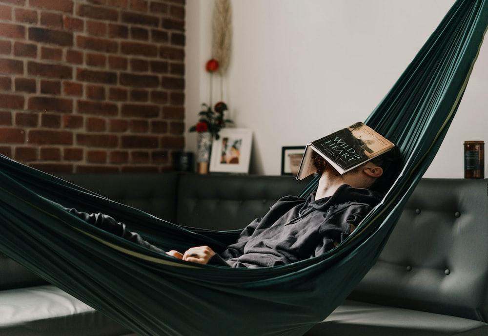 woman in black hijab reading book
