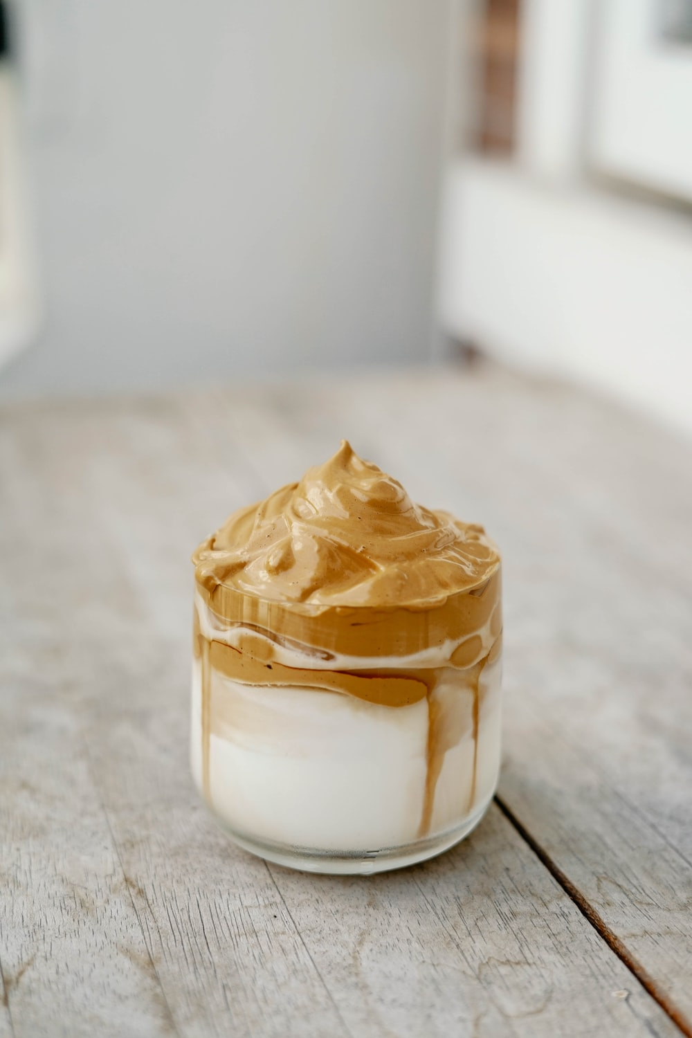 white and brown ice cream in clear glass container