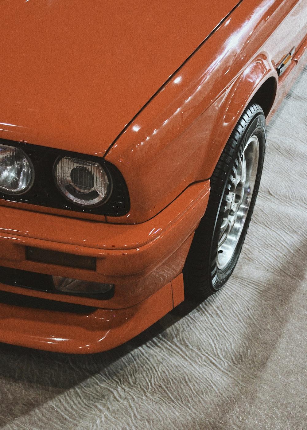 orange car on gray concrete floor
