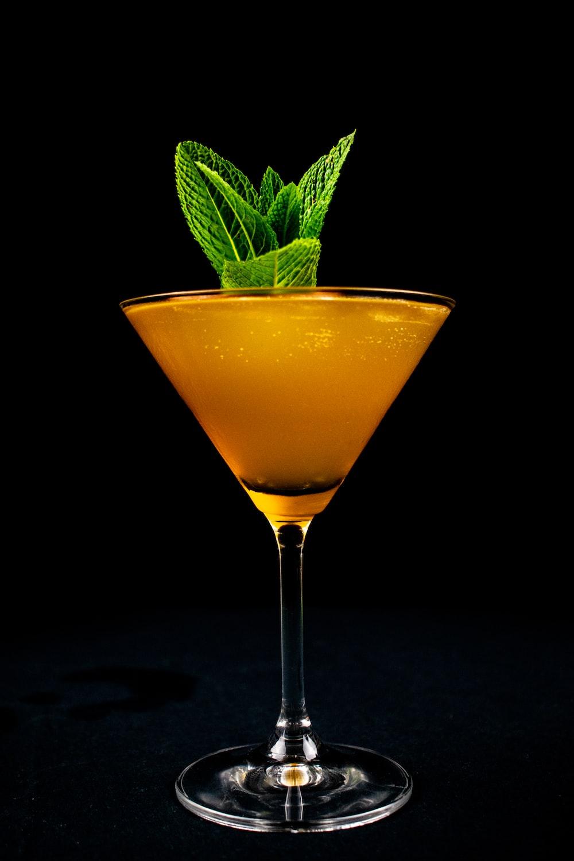 orange liquid in clear cocktail glass