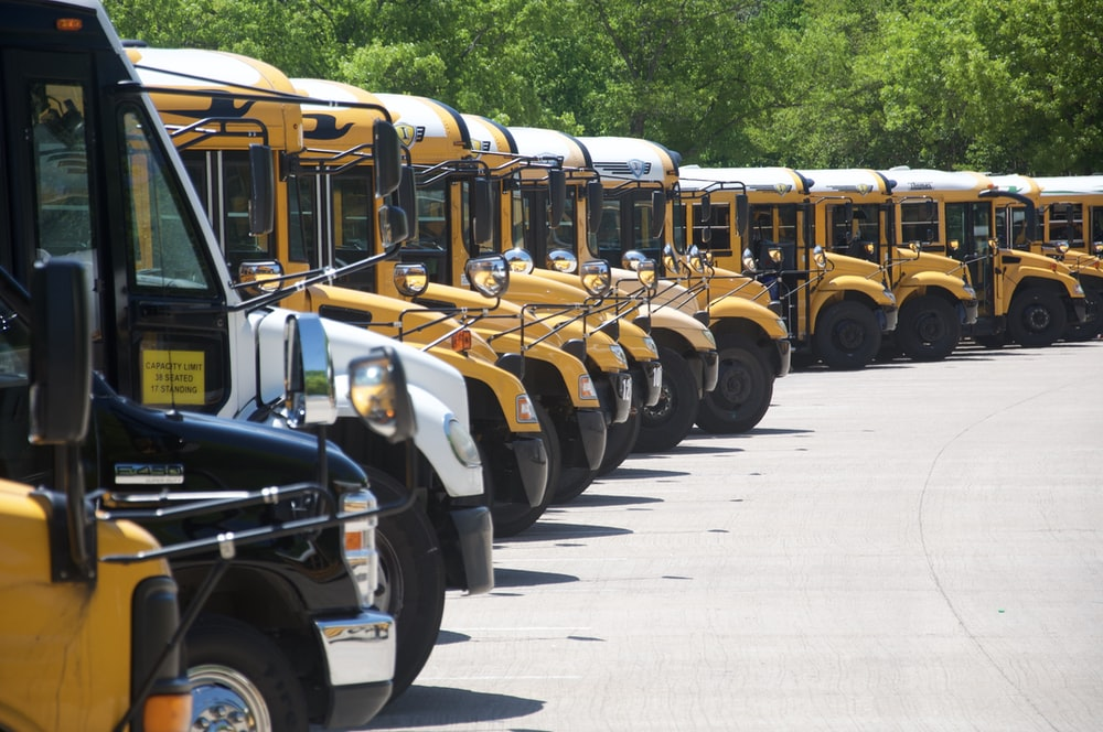 yellow school bus on road during daytime