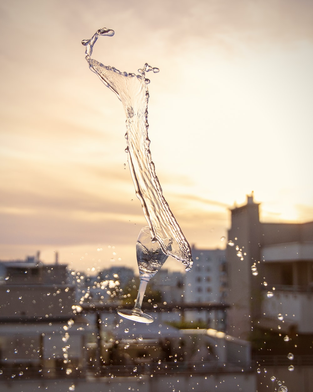water drop on glass during sunset