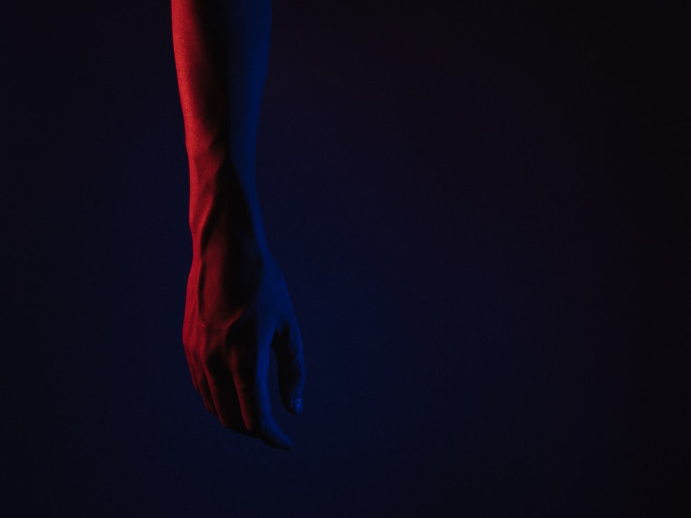 persons hand with blue paint