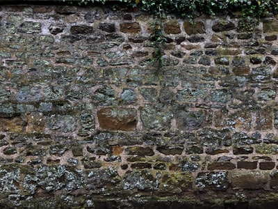 brown and gray brick wall blarney stone teams background