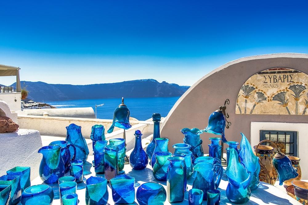 blue glass bottles on blue glass table
