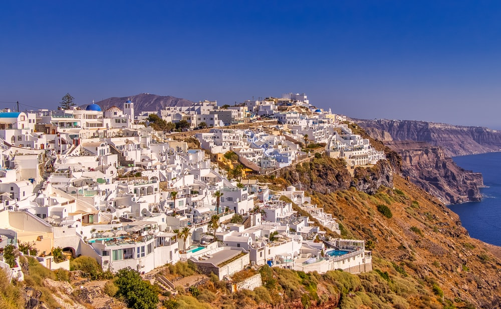 white and brown concrete buildings on hill during daytime