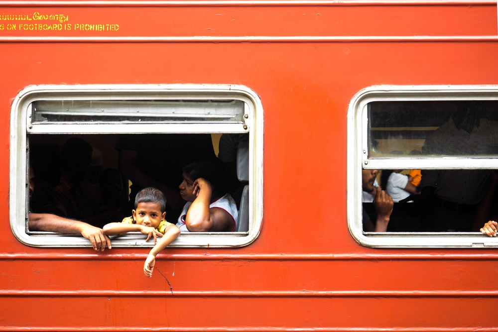 2 men sitting on red train