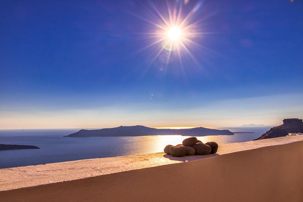 brown rocks on white sand during daytime