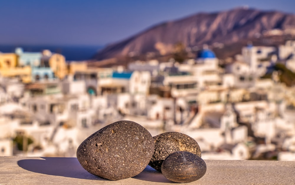 black stones on white sand during daytime
