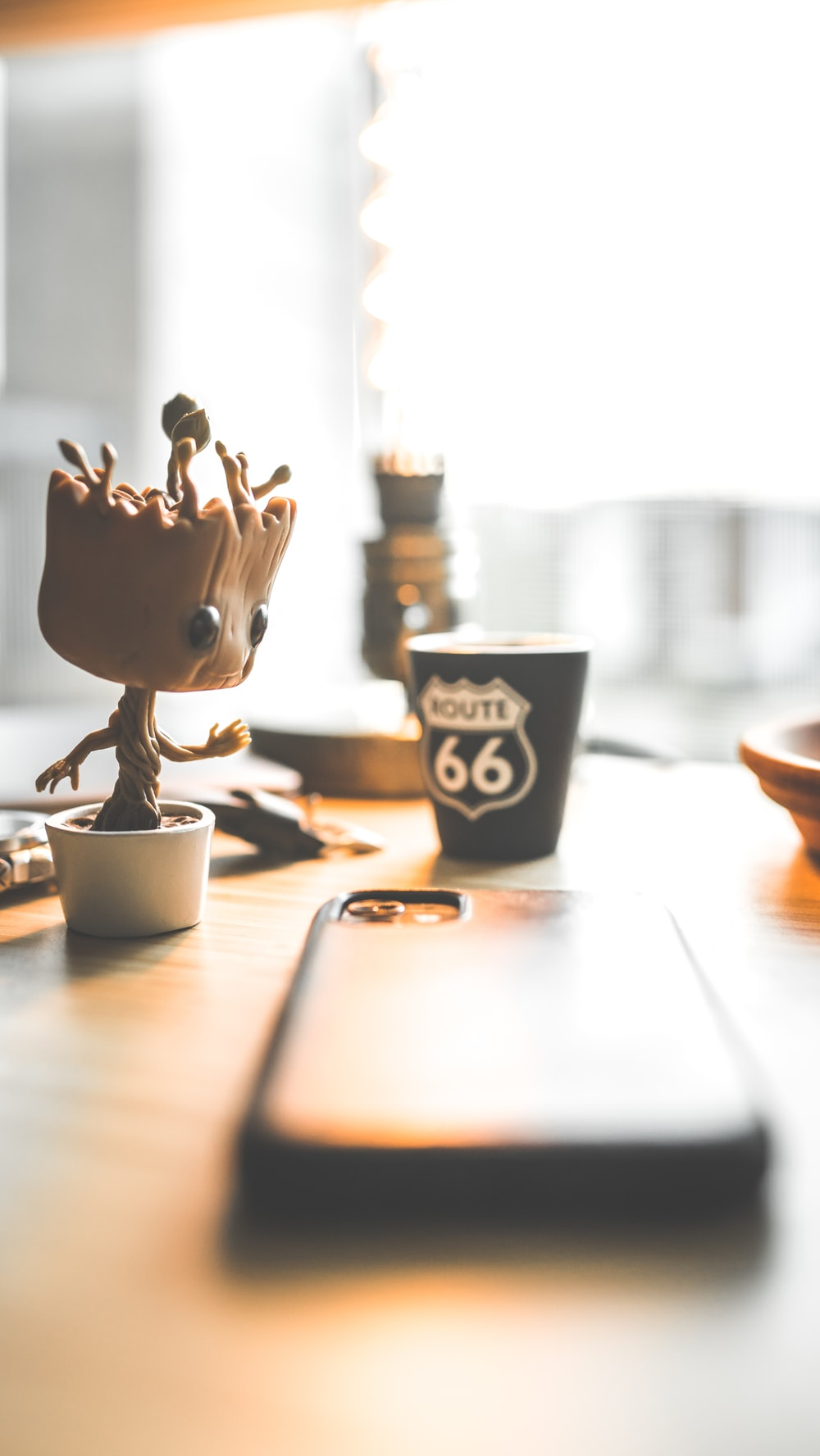 brown wooden animal figurine on brown wooden table