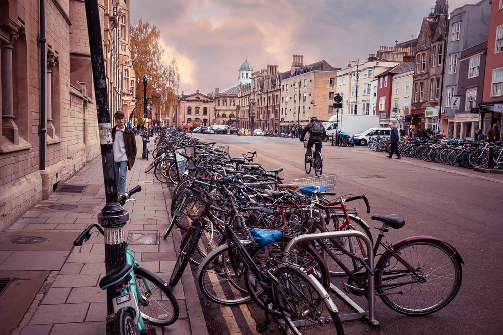 bicycles parked on sidewalk near buildings during daytime