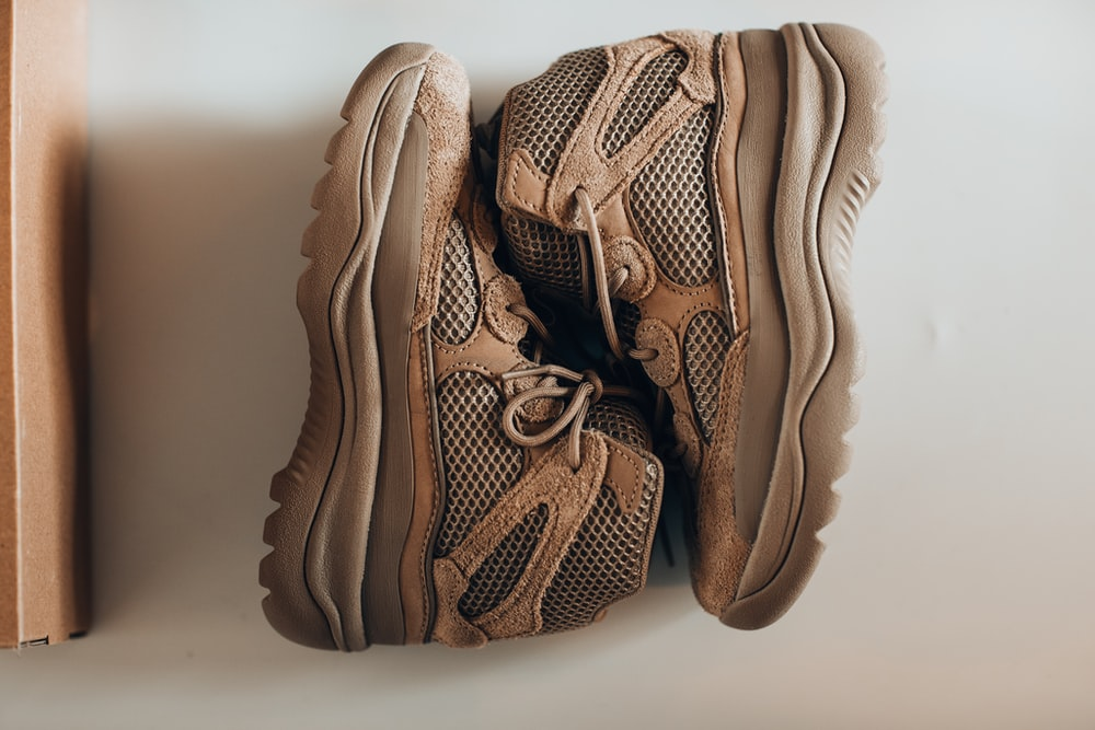 brown and black nike athletic shoes
