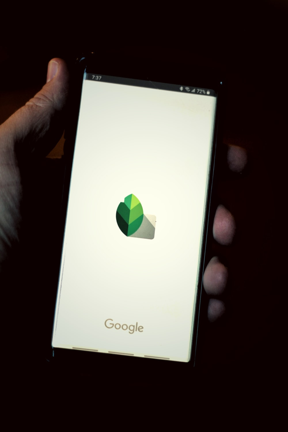 white sony xperia smartphone displaying google search