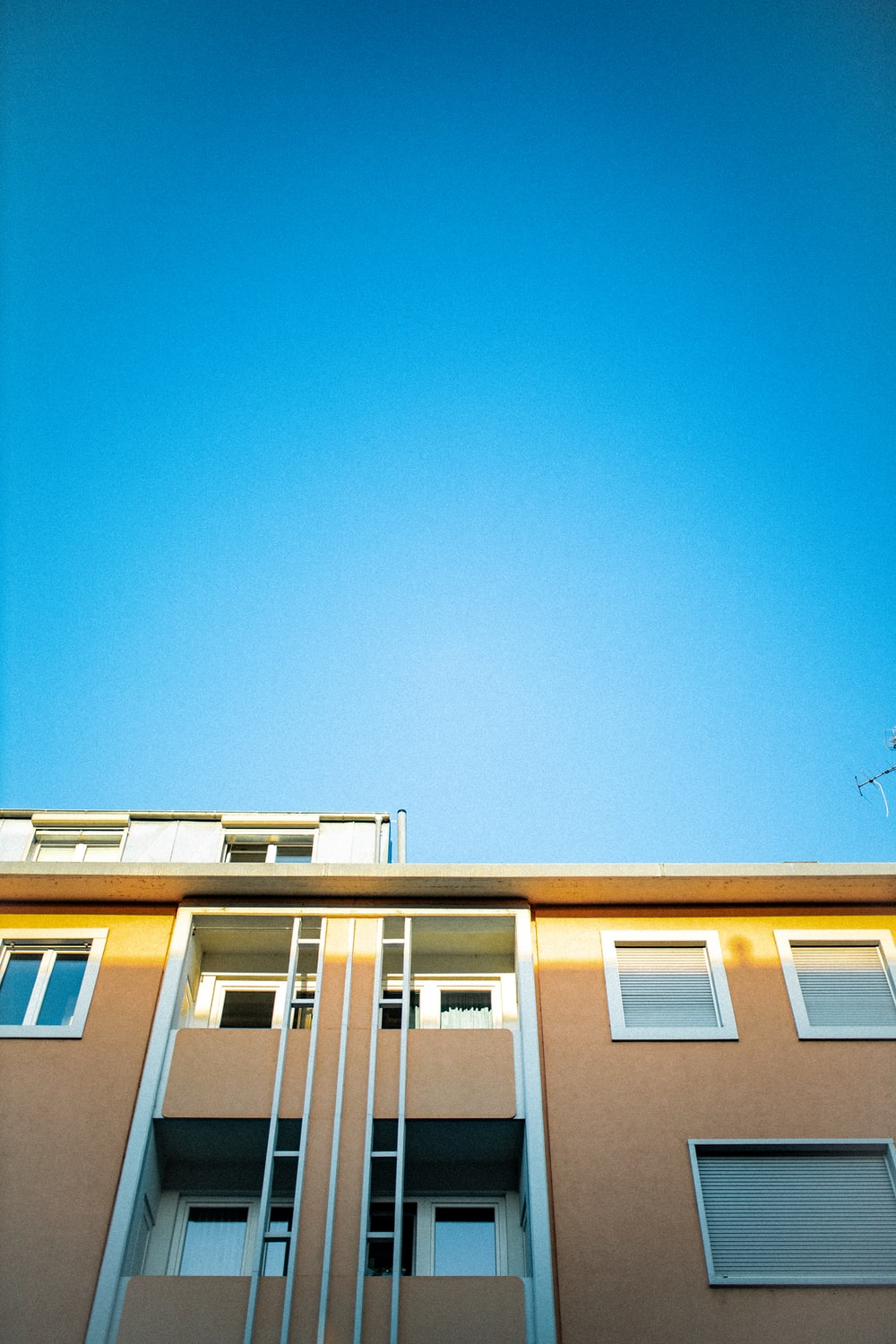 white and blue concrete house under blue sky during daytime