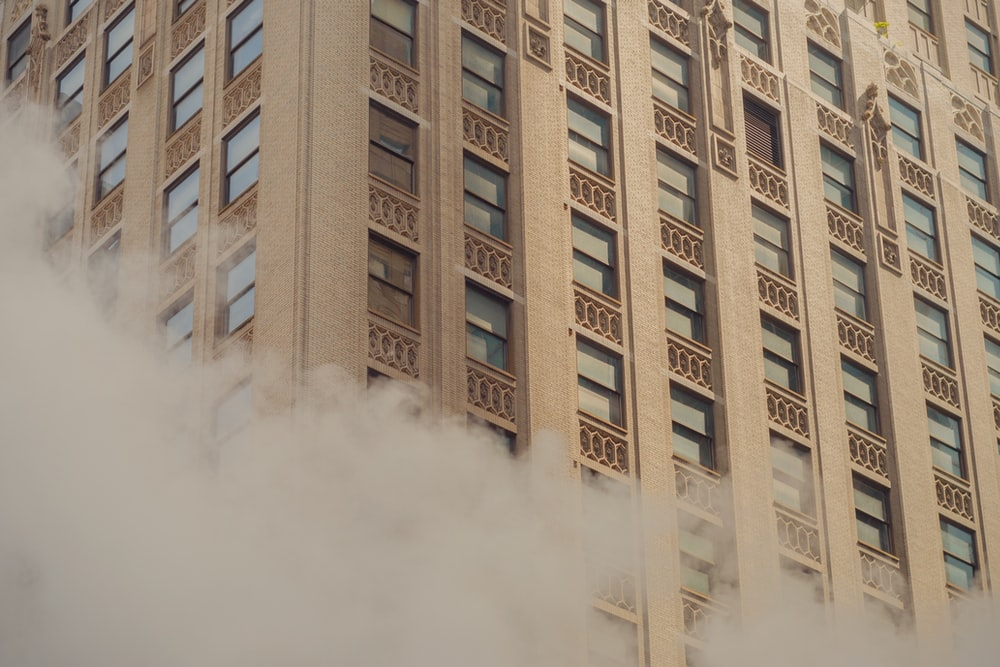 brown concrete building with white smoke