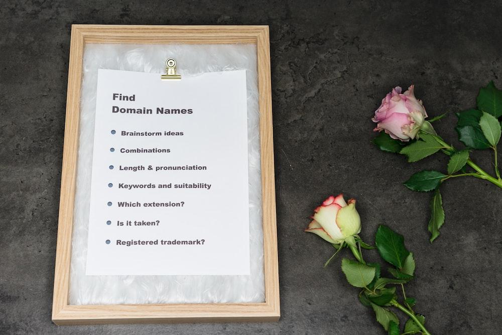 brown wooden framed white printer paper
