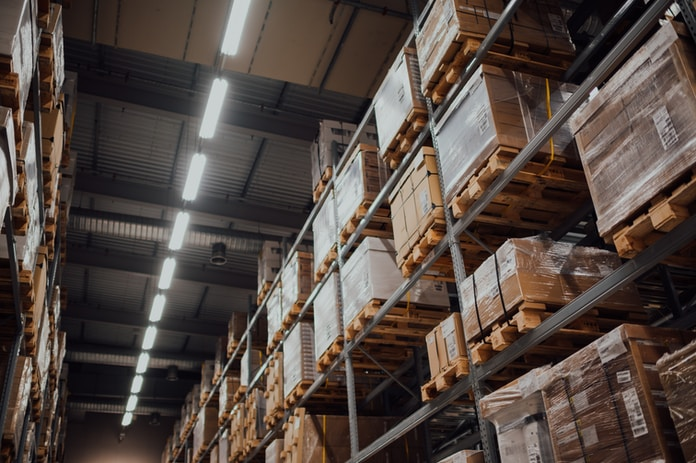 brown cardboard boxes on white metal rack