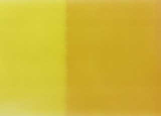 yellow textile on brown wooden table