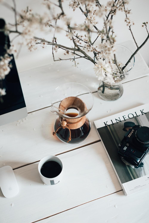 brown ceramic mug on white table