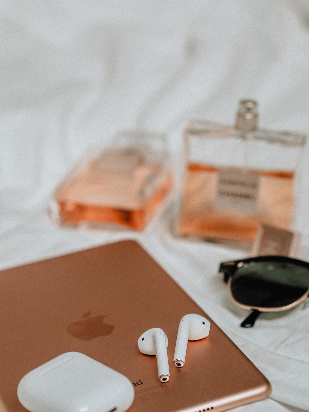 black sunglasses beside white apple earpods