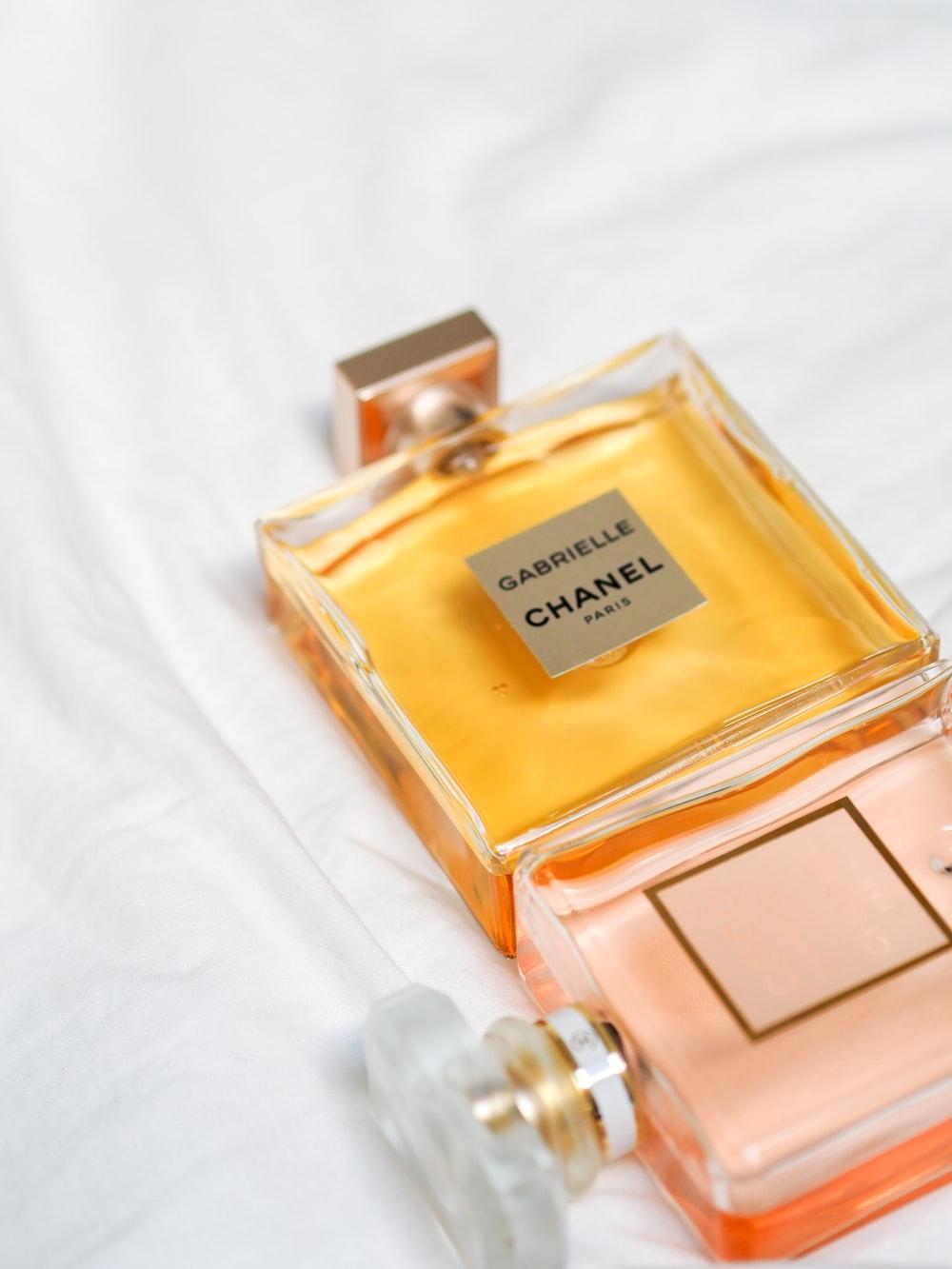 gold perfume bottle on white textile