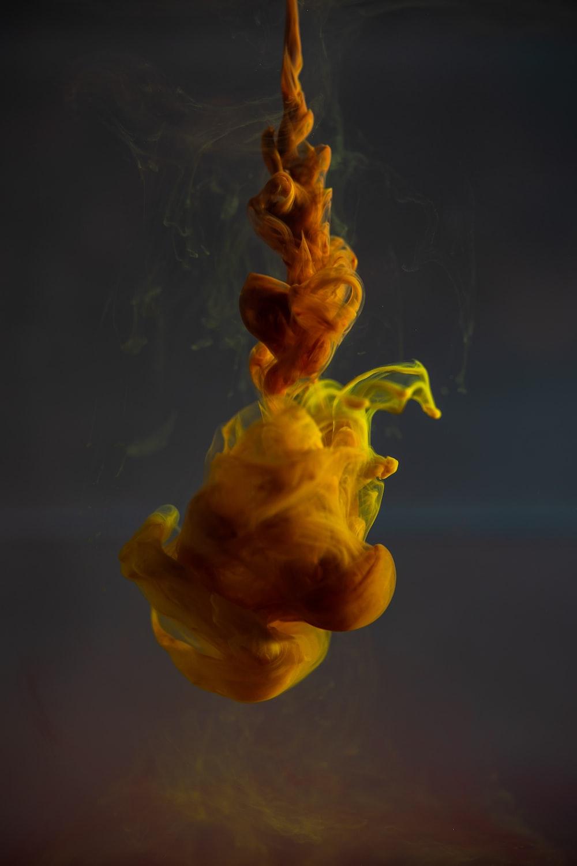 yellow smoke in a blue water
