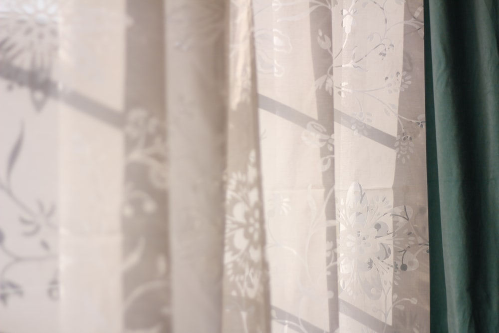 white and brown floral curtain