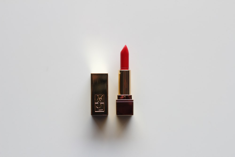 red lipstick on white table