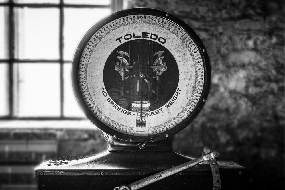 grayscale photo of a analog watch