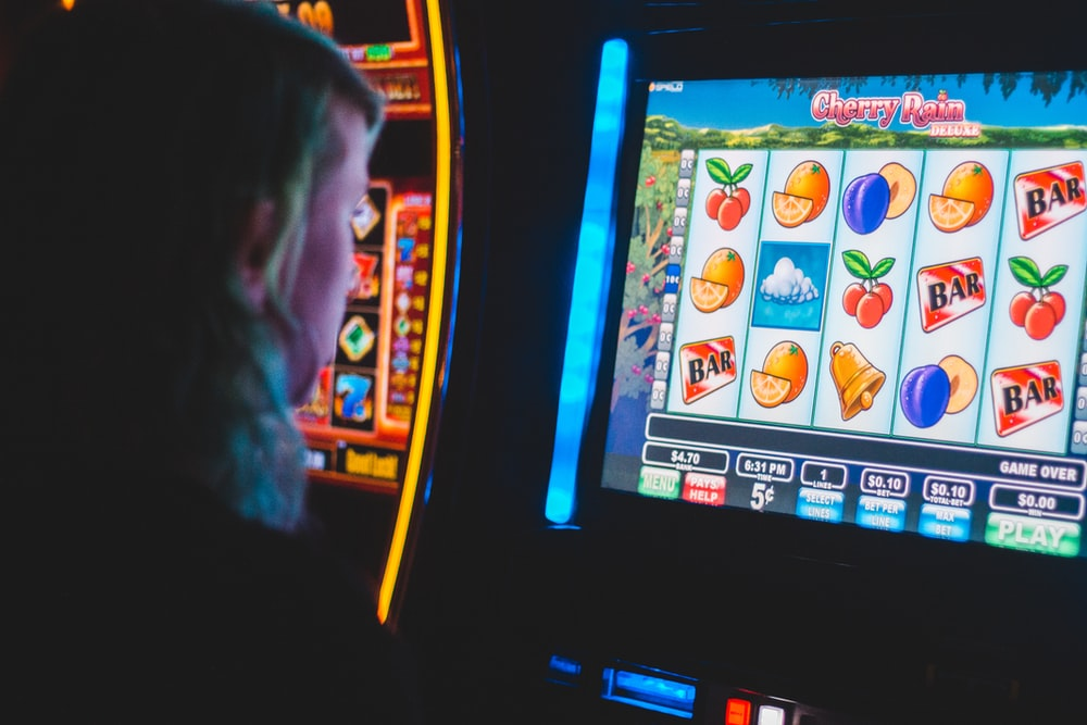 man playing slot machine game