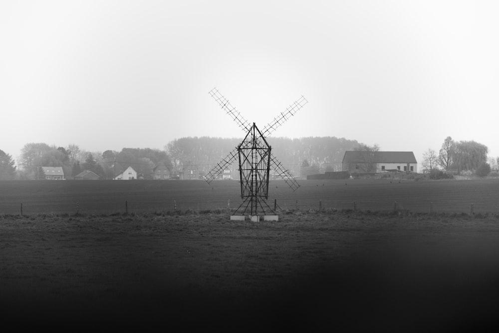 windmill near body of water