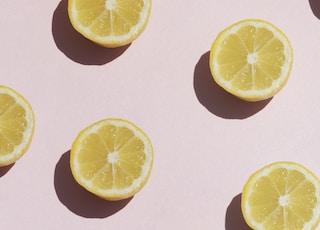 sliced lemon on white surface