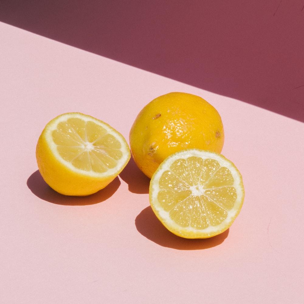 sliced lemon on orange table