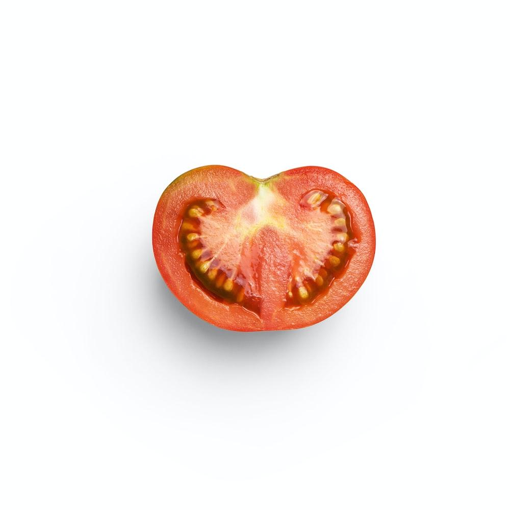 sliced tomato on white background