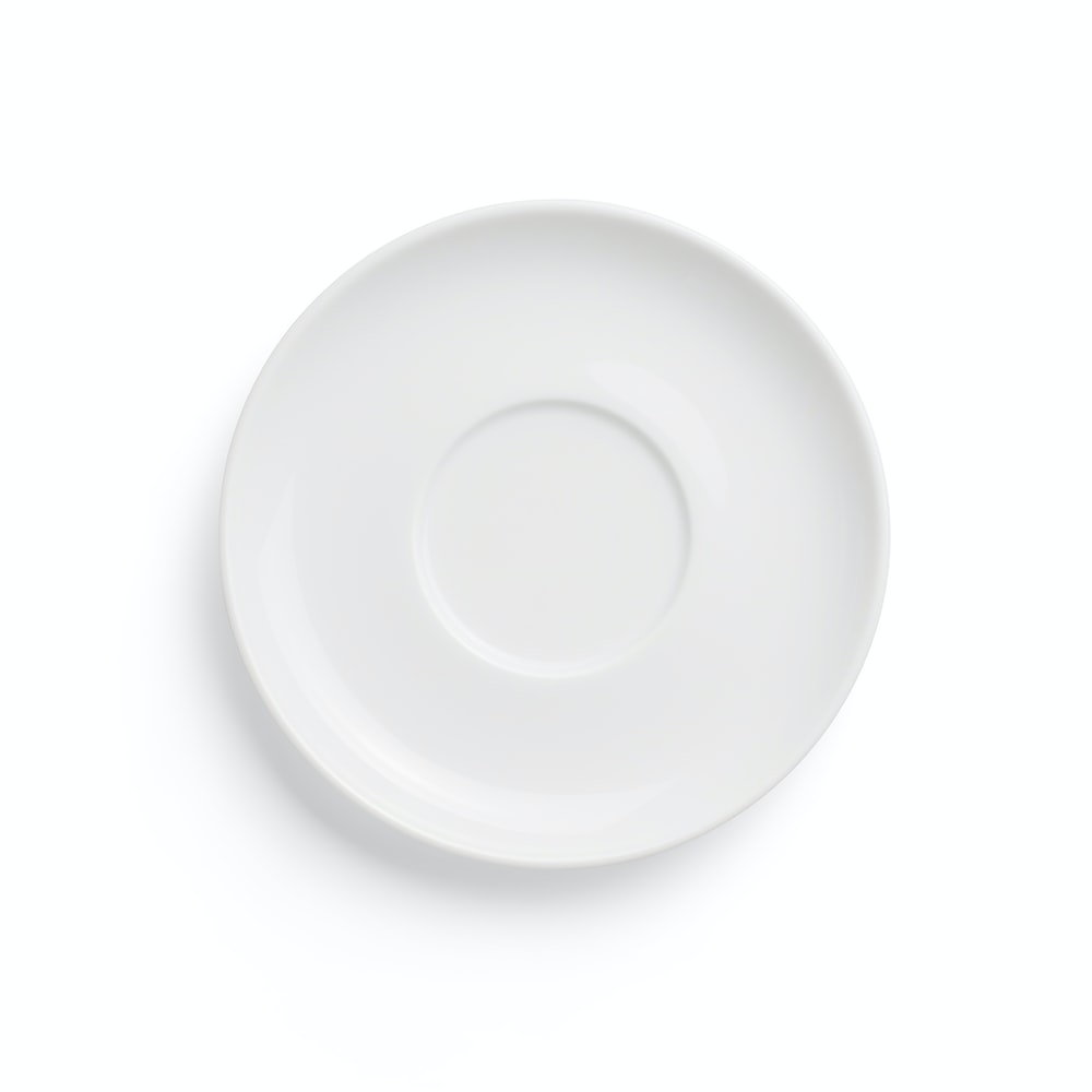 round white ceramic plate on white background