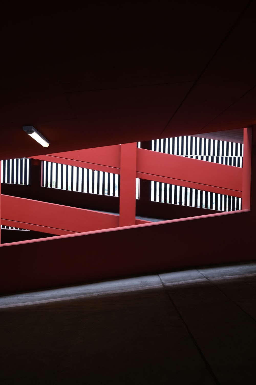 red wooden fence on brown floor tiles